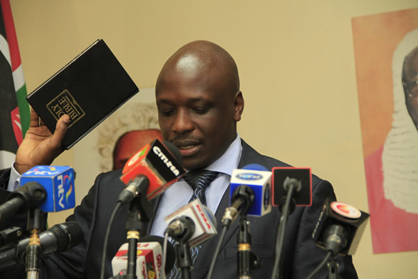 Apollo Mboya taking his oath