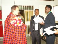 Dr Seger, Chaiperson and Commissioner exchange Notes during the courtesy call